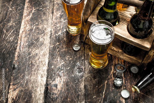 Fototapeta box with bottles of fresh beer. obraz na płótnie