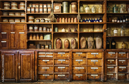 Bottles on the shelf in old pharmacy. Retro style.