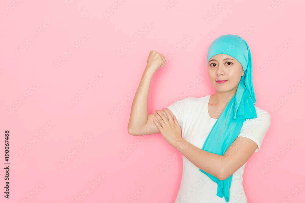 Fototapeta cancer patient woman standing in pink background