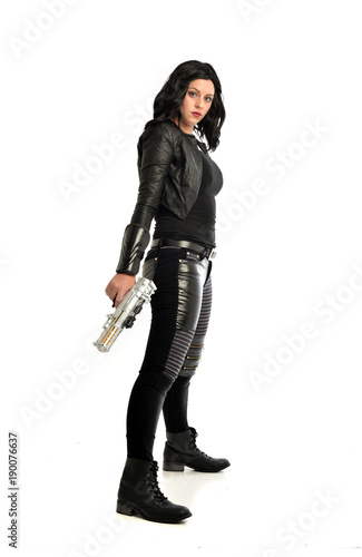Photo  full length portrait of black haired girl wearing leather outfit