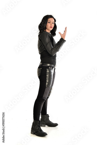 full length portrait of black haired girl wearing leather outfit Poster