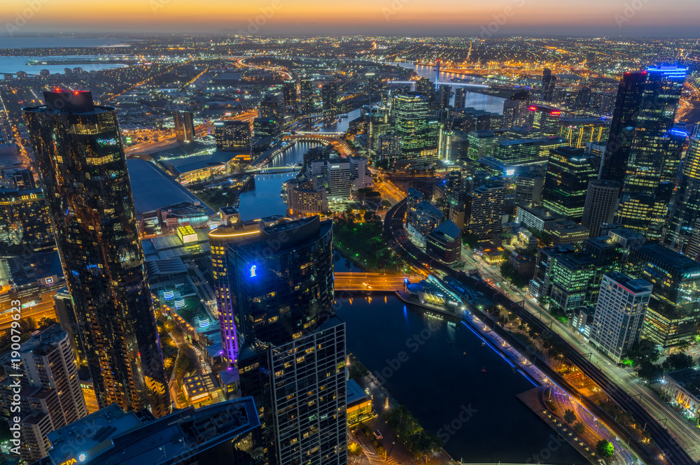 Fototapeta Aerial view of Melbourne along the Yarra River towards Docklands