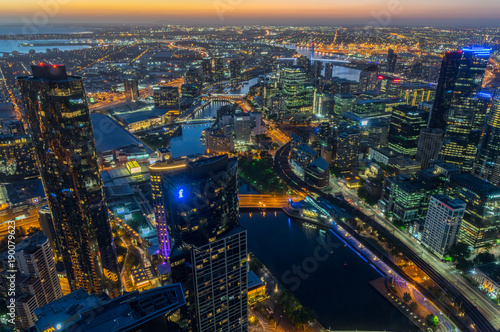 Valokuva  Aerial view of Melbourne along the Yarra River towards Docklands