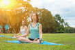 Group of beautiful girl meditates in nature.