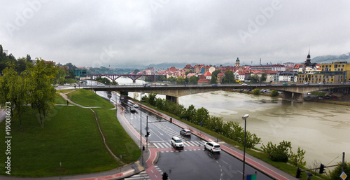 Poster Channel Panoramic city buildings view rainy autumn weather, Maribor Slovenia.