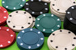 poker chips on a green background