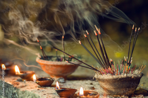 Photo sur Aluminium Buddha Burning aromatic incense sticks. Incense for praying Buddha or Hindu gods to show respect