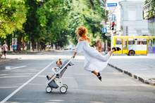 Mom With A Stroller Crosses Th...