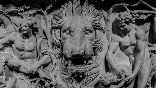 Photo Stone bas-relief of lion and gods