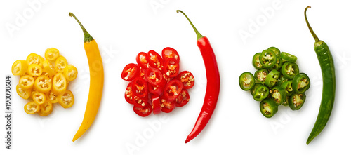 Poster Hot chili peppers Whole and chopped colorful chili peppers