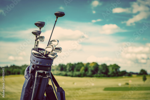 Acrylic Prints Golf Golf equipment bag standing on a course.