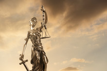 Justice Statue Against Cloudy Sunset.
