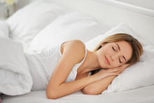 Young Woman Sleeping On White ...