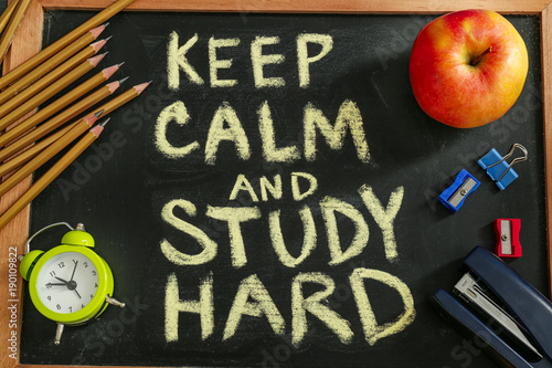 Fotografie, Obraz  Composition with phrase Keep calm and study hard and stationery on chalkboard,