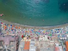 Beach Umbrellas And Building Along The Sea Coast