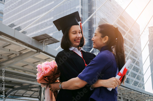 f6375ea7df0 You did it. happy asian mother hug with flower and congratulation graduation  to her caucasian daughter