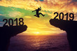 Leinwanddruck Bild - A man jump between 2018 and 2019 years.