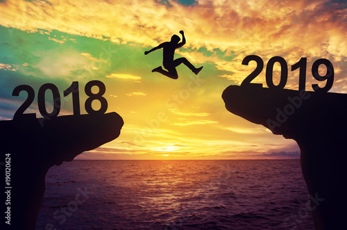 Fotografia, Obraz  A man jump between 2018 and 2019 years.