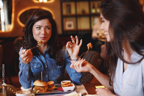 Two young women at lunch in a restaurant - 190123068