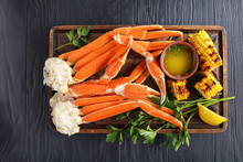Close-up Of Crab Legs And Corn Cobs
