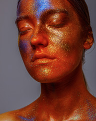 Bright neon make-up, creative body art on the theme of space and stars.Space fairy,woman and universe