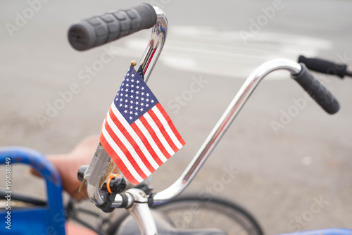 Photo Stands Bicycle Decorated America flag on handlebar of a bicycle.