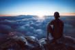 canvas print picture - Junger Mann mit weitem Blick über die Wolken