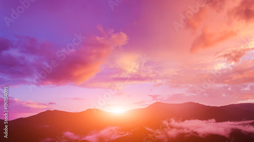 Twilight sky in purple over the mountain. #190154095