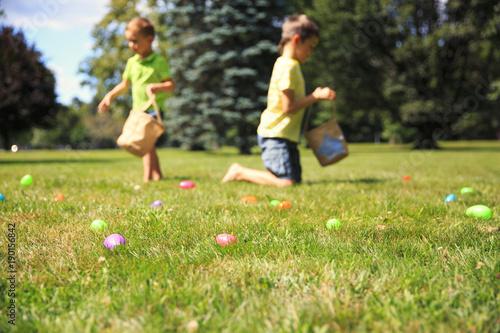 Fotografie, Obraz  Easter eggs hunting outdoors