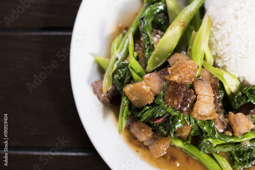 Chinese broccoli and crispy pork belly stir fry over rice