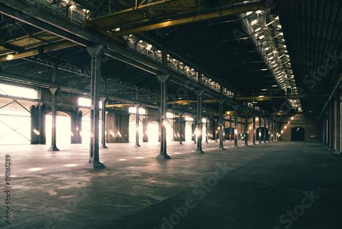 Papiers peints Les vieux bâtiments abandonnés Old and dusty warehouse, with light coming through openings