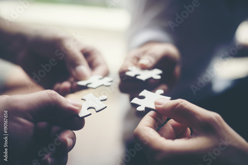 Hand holding jigsaw puzzles, Business partnership concept. Canvas Print
