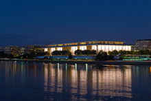 Washington DC Night Panorama With John F. Kennedy Center For The Performing Arts In The Center Of The Frame. Brightly Lit The Kennedy Center With Reflection In Dark Waters Of Potomac River.