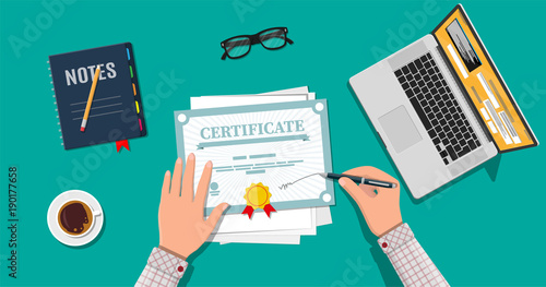 Photo Businessman hand signs certificate.