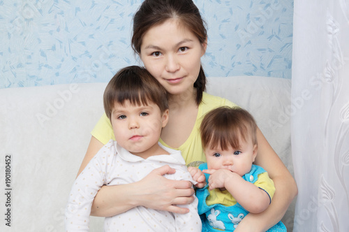 Fényképezés  Mother with two daughters, multinational family with Asian mom and Caucasian lit
