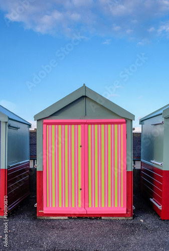 a beach hut with a multi coloured door stripey yellow pink colours & a beach hut with a multi coloured door stripey yellow pink ...