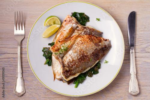 Fotografie, Obraz  Roasted sea bream with spinach
