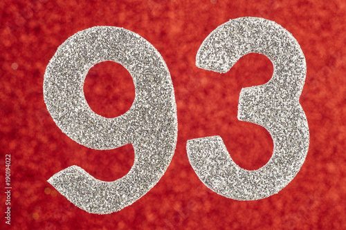 Fotografie, Obraz  Number ninety-three silver color over a red background