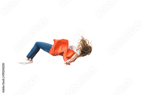 Obraz side view of girl in red mantle falling isolated on white - fototapety do salonu