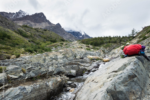 Backpacker's bag at Torres del Paine, water break at cascade, W Circuit, Patagon Canvas Print