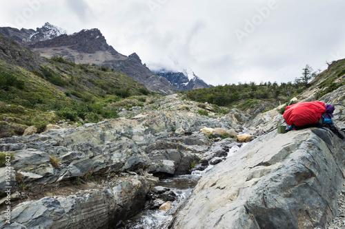 Backpacker's bag at Torres del Paine, water break at cascade, W Circuit, Patagon Wallpaper Mural