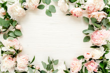 Floral Pattern, Frame Made Of Pink Peonies  Branches Of Eucalyptus And Leaves On Wooden White Background. Flat Lay, Top View. Valentine's Background. Floral Frame. Frame Of Flowers. Flowers Texture