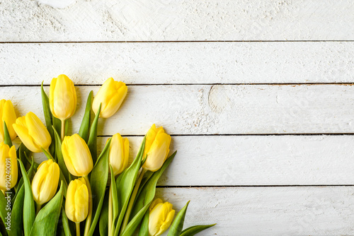 Foto op Plexiglas Tulp Yellow tulips, spring easter background or anniversary gift for mothers day or card for women's day at 8 march