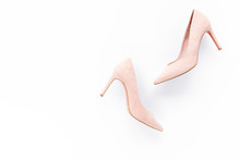 Pale Pink Female Shoes On White Background. Flat Lay, Top View Trendy Fashion Feminine Background. Beauty Blog Concept.