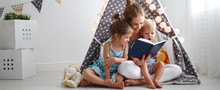 Family Mother Reading To Child...