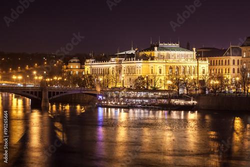 Rudolfinum concert hall at the Vltava riverbank by night Poster