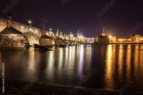 Charles Bridge and buildings along the Vltava at night, in Prague, Czech Republi Poster