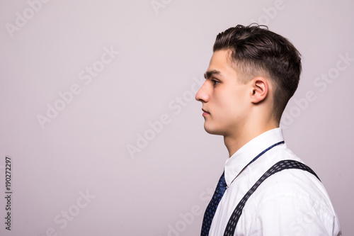 Valokuva  Side view portrait of confident man with beautiful hairstyle in white shirt look