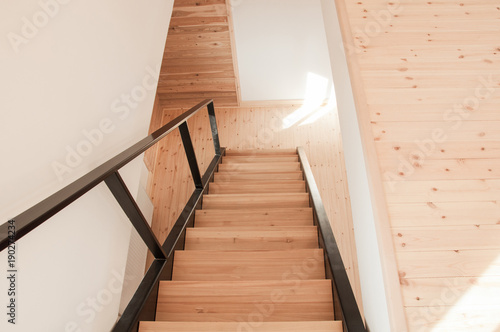 Foto op Canvas Trappen Metal staircase with wooden treads