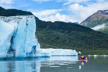 Kayaker Paddling Away From Ter...